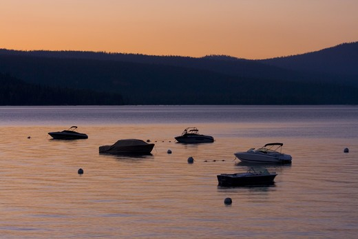 Stock Photo: 4286-72905 Silhouettes of power boats on Lake Tahoe at sunset