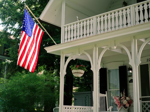 Stock Photo: 4286-74248 USA New York Chautauqua,Victorian home displaying the American flag
