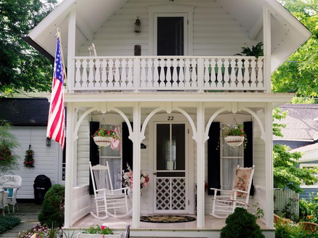 USA New York Chautauqua,Victorian home displaying the American flag : Stock Photo