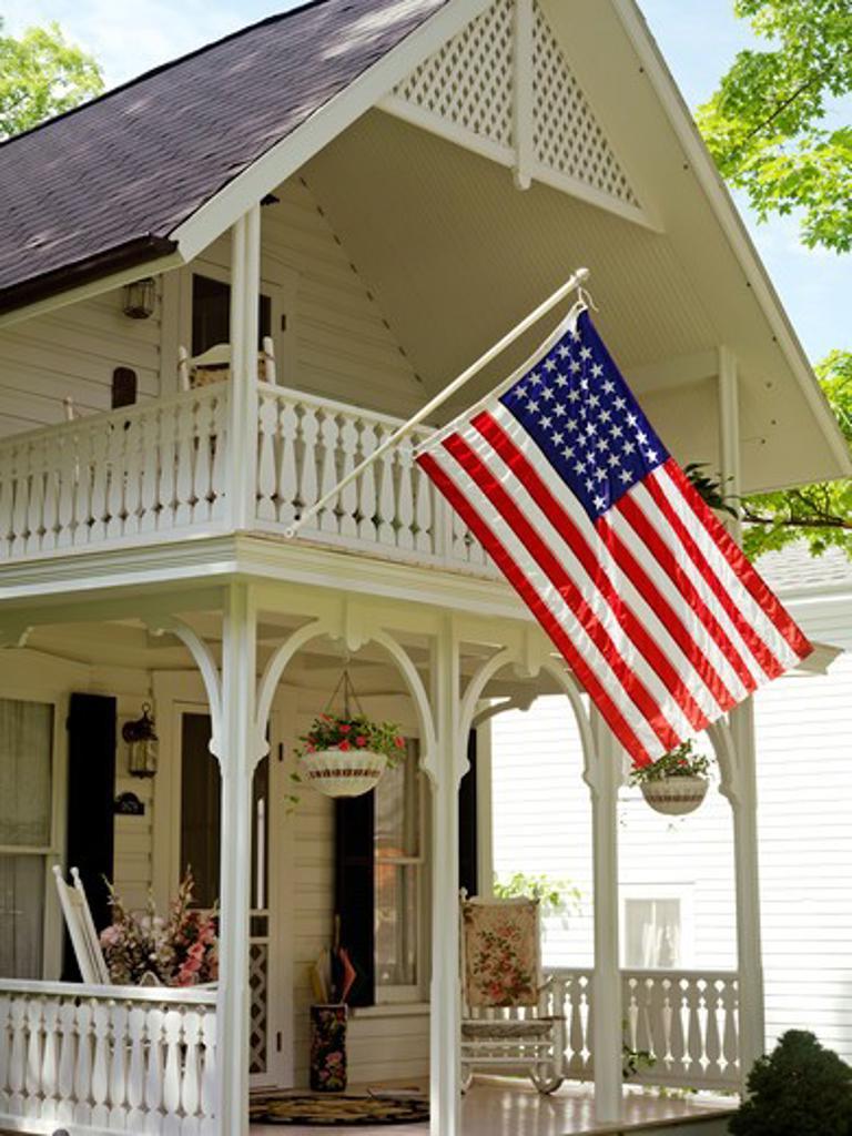 Stock Photo: 4286-74250 USA New York Chautauqua,Victorian home displaying the American flag