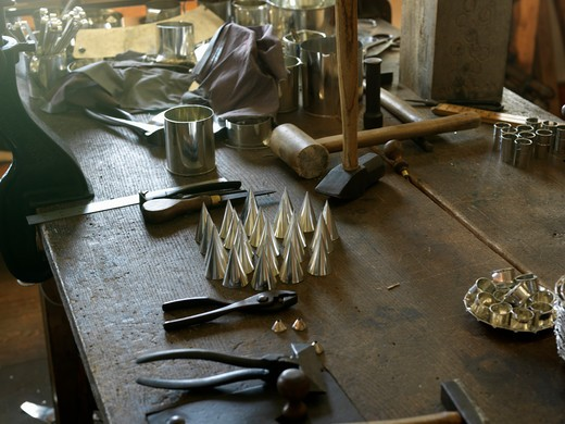 Stock Photo: 4286-74335 Canada,Ontario,Morrisburg,Upper Canada Village, recreation of pioneer life circa 1860's, tinsmith tools and parts for a tin candlestick holder