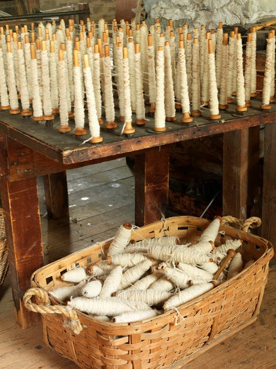 Canada,Ontario,Morrisburg,Upper Canada Village, recreation of pioneer life circa 1860's,spun sheep wool : Stock Photo