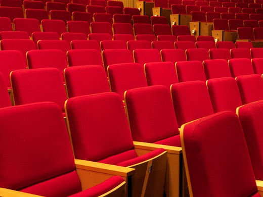 United Kingdom Manchester,rows of empty red seats in an auditorium : Stock Photo
