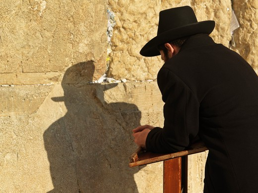 Israel, Jerusalem, Western Wall or Wailing Wall with worshipper and prayer slips : Stock Photo