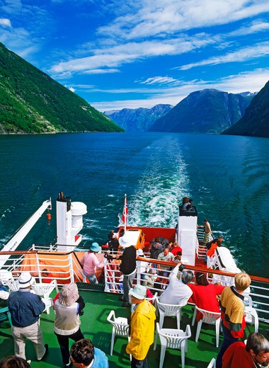 Passengers on deck of car ferry on Geirangerfjord in Norway : Stock Photo