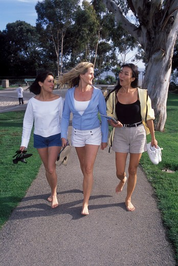 Stock Photo: 4286-75340 Three ladies Latina Caucasion Asian in California city park