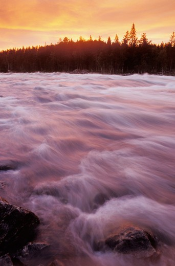 Stock Photo: 4286-75417 Mardsele Falls near Lappland Sweden like a cataract of fire ignited by sunset