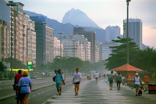 People taking morning walk along Copacabana Beach in Rio de Janeiro Brazil : Stock Photo