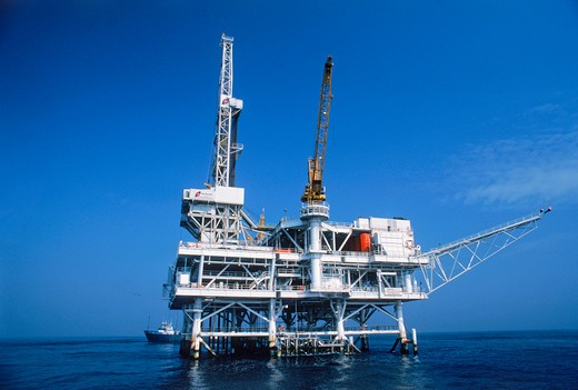 Offshore Pacific Ocean oil rig off Huntington Beach, California : Stock Photo