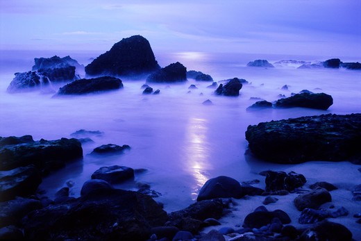 Stock Photo: 4286-76371 Waves and moon light painting rocky shore at dusk at Woods Cove in Laguna Beach, California