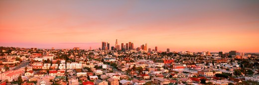 Downtown Los Angeles skyline over East Los Angeles suburbs at sunset : Stock Photo