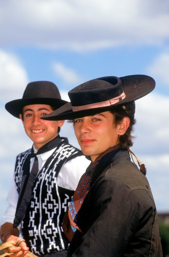 Stock Photo: 4286-76500 Young gauchos on horseback with hats in Argentina