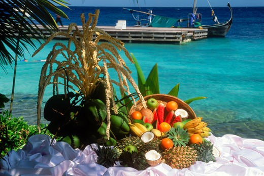 Stock Photo: 4286-77128 Baskets of fresh fruits including coconut, pineapple, papaya, guava and apples next to harbor on Fihalhohi Island in Maldives