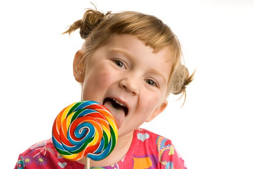 Stock Photo: 4286-77265 Little girl with lollypop, white background