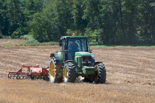 AGRICULTURE. PLOWING THE FIELD. : Stock Photo