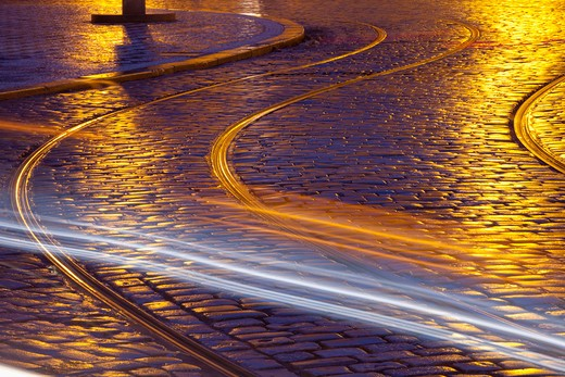 Stock Photo: 4286-78454 prague - tram tracks and cobblestone street at dusk after rain