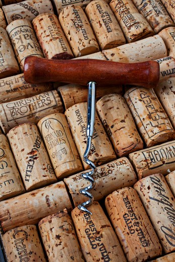 Stock Photo: 4286-78665 Wine corkscrew on corks