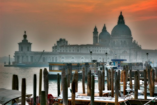 Italy. Venice. Basilica of St Mary of Health seen through mooring poles nearby Saint Mark's Square. : Stock Photo