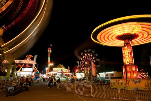 Stock Photo: 4286-79271 Evergreen State Fair people enjoying the amusement rides and game booths at night Monroe Washington State USA