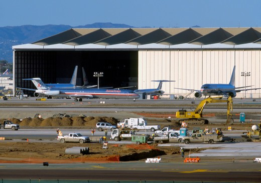 Group of American Airlines jets near service hangar at Los Angeles International Airport, LAX, while construction work is performed on runways during fall of 2006 : Stock Photo