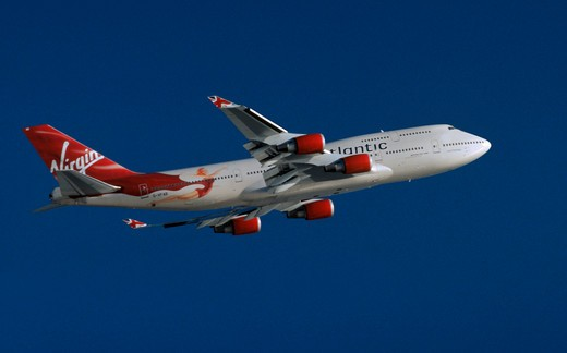 Lady Penelope takes to the skies - a Virgin Atlantic owned Boeing 747 Jumbo jet ascending after takeoff from Los Angeles International Airport, also known as LAX : Stock Photo