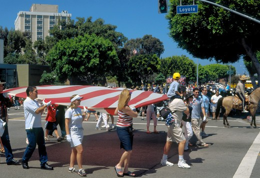 Huge flag carried by group in Independence Day Parade in Westchester, Los Angeles, California : Stock Photo