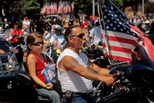 Ready to roll - Harley Davidson rider with young companion waits for Independence Day Parade to begin in Westchester, Los Angeles, California : Stock Photo
