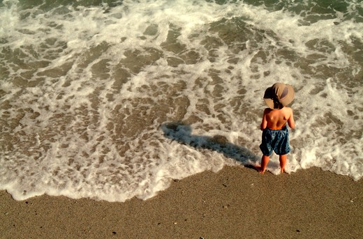 Stock Photo: 4286-80213 Toddler boy on beach