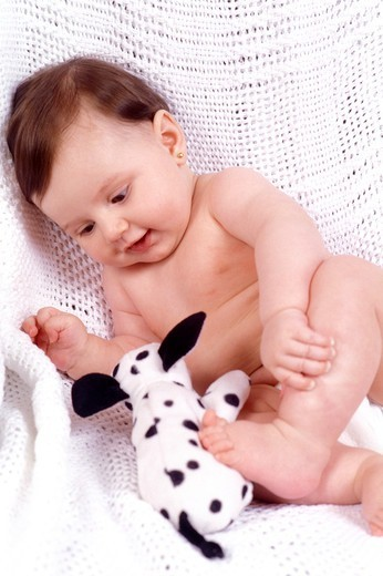 Stock Photo: 4286-80615 Baby (12-15months) holding toy