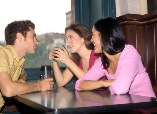 Stock Photo: 4286-80749 Friends sitting in coffee shop, side view