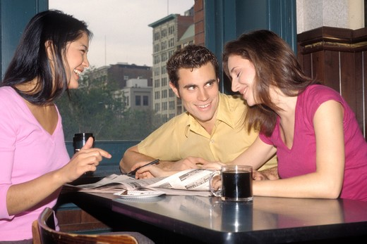 Stock Photo: 4286-80752 Friends sitting in coffee shop, side view