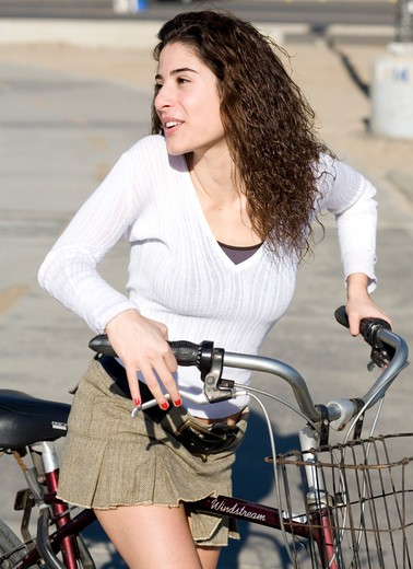 Stock Photo: 4286-81204 Young woman with bicycle, smiling, portrait