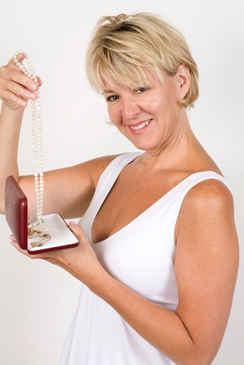 Stock Photo: 4286-81454 Mature woman with jewel casket, smiling, portrait