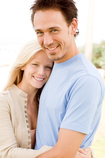 Mature couple embracing each other, smiling : Stock Photo