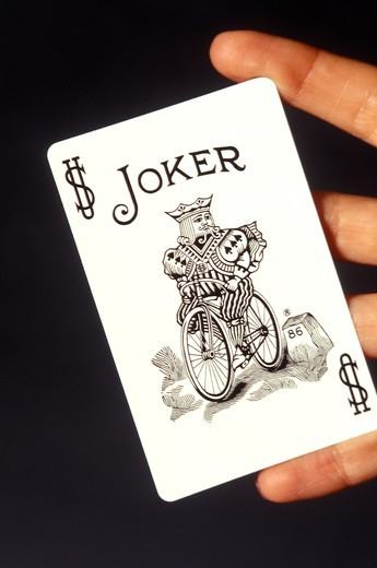 Stock Photo: 4286-82230 Playing card on fingers,close up