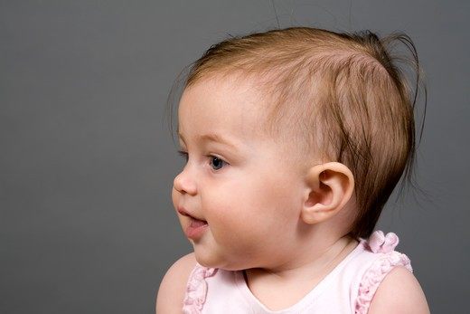 Stock Photo: 4286-82684 Baby girl (9-12 months),close up