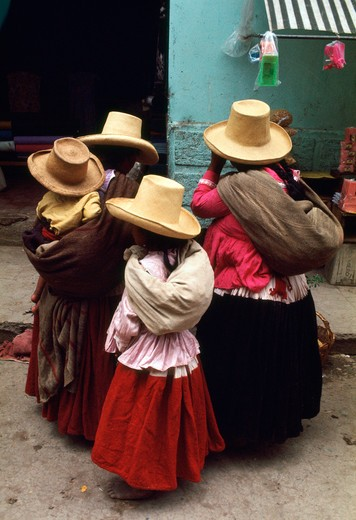 Stock Photo: 4286-84116 Women and child, natives of Cajamarca, Peru, wear hats typical of the region.