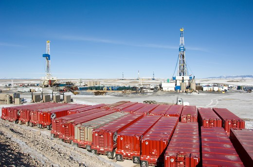 Stock Photo: 4286-84295 Water trailers near drilling rigs in Wyoming.