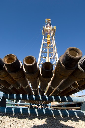 Stock Photo: 4286-84345 Drill pipe on rack by drilling rig.