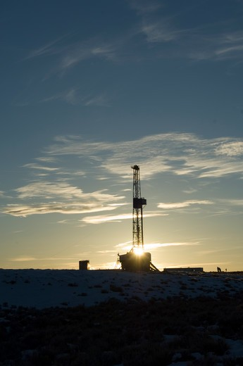 Wyoming sunset with drilling rig. : Stock Photo