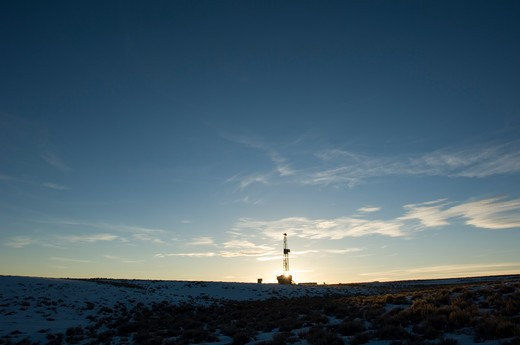 Stock Photo: 4286-84354 Lonely drilling derrick at Wyoming sunset.