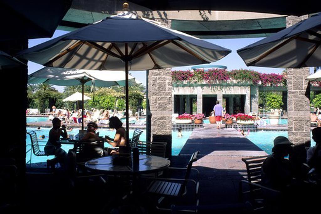 Stock Photo: 4286-84746 People in swimming pool Hyatt at Gainey Ranch Scottsdale near Phoenix Arizona