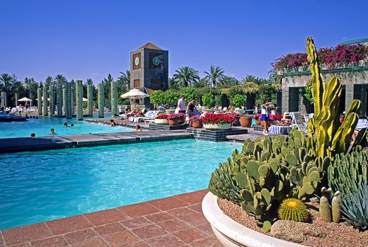 Stock Photo: 4286-84748 People at swimming pool at Hyatt at Gainey Ranch Scottsdale near Phoenix Arizona