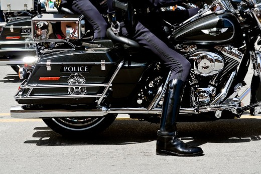 Close up of a police officer?s legs on a motorcycle : Stock Photo