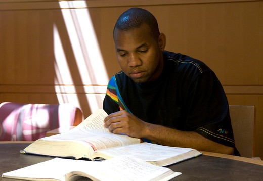 African American man reading and studying : Stock Photo