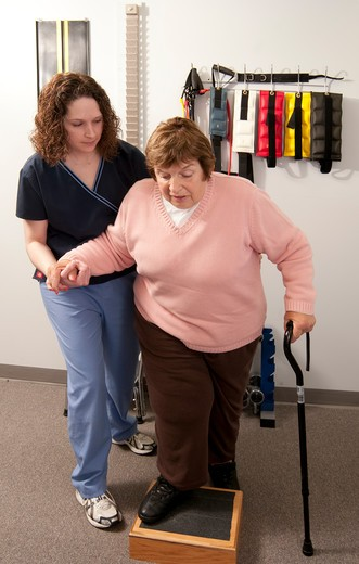 Stock Photo: 4286-85639 Physical therapist working with an older woman suffering from Lymphedema