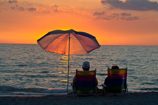 Stock Photo: 4286-85781 couple relaxing at the beach-sunset-florida west coast-2008