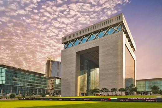 Dubai Financial District.  The Gate Building housing the DIFC, the international finance centre. : Stock Photo