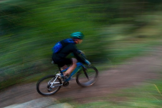 Mountain bikers riding through muddy trails in Lefthand Canyon near Boulder, Colorado : Stock Photo