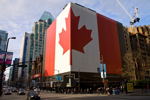 Stock Photo: 4286-90103 Huge patriotic Canadian Flag on building during the 2010 Winter Olympic Games, Vancouver, Canada